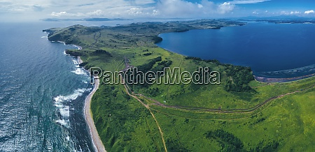aerial panorama of green coastal landscape