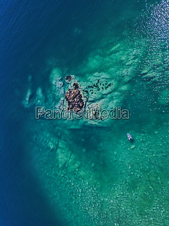 aerial view of boat sailing in