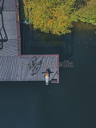 aerial view of young woman lying