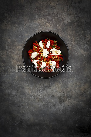 bowl of vegetarian salad with red