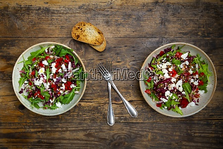 two bowls of vegetable salad with