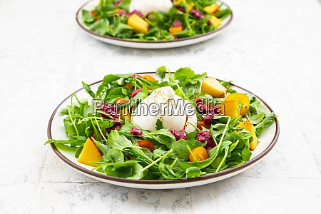two plates of vegetarian salad with
