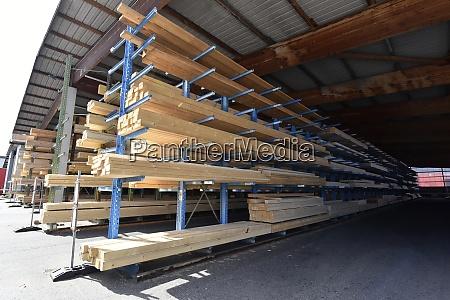 planks stored on warehouse rack