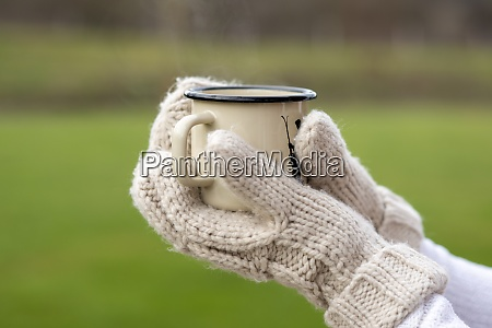 hands of young woman wearing gloves
