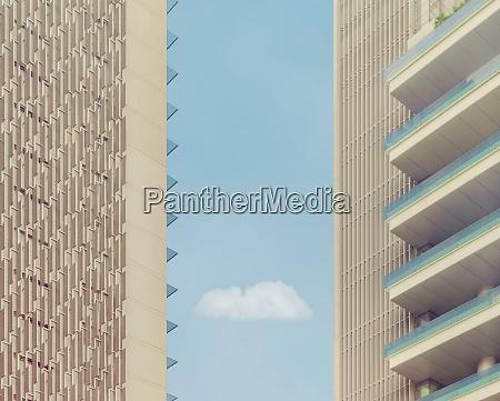 cloud seen amidst buildings against blue