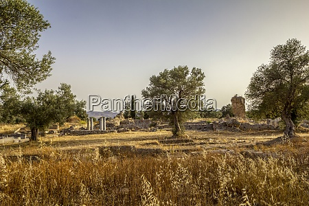 ancient apollon temple during sunset at
