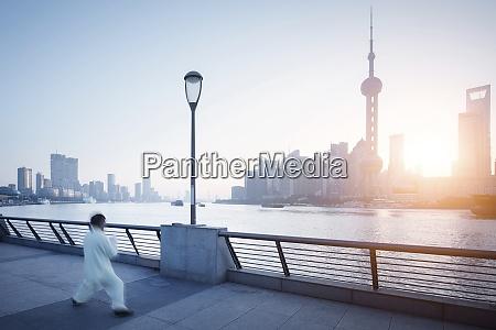 china shanghai skyline athlete in the