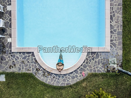 drone, view, of, man, relaxing, swimming - 29121702