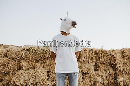 portrait of young man wearing unicorn
