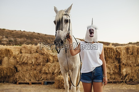 portrait of white horse and young