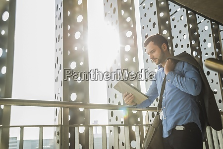 young businessman looking on digital tablet