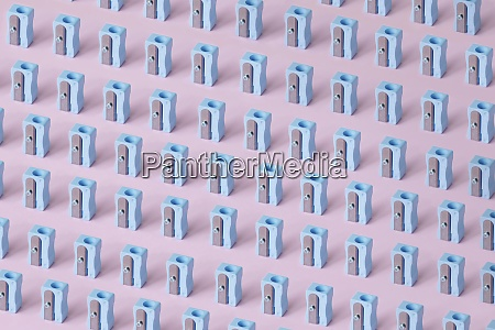 pattern of blue erasers against pink