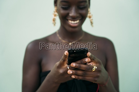 young woman using mobile phone while