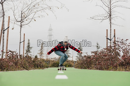 young woman skateboarding outdoors