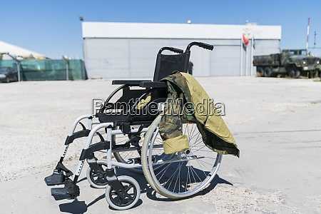 military uniform on empty wheelchair at