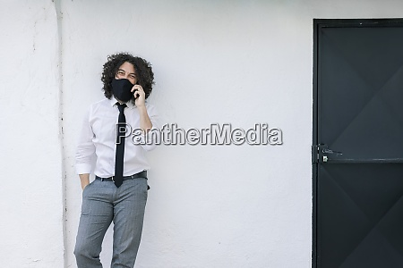 businessman with face mask talking on