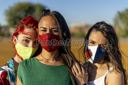 friends wearing colorful face mask while