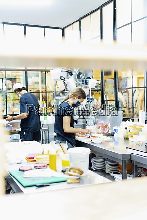 chefs cooking in commercial kitchen at
