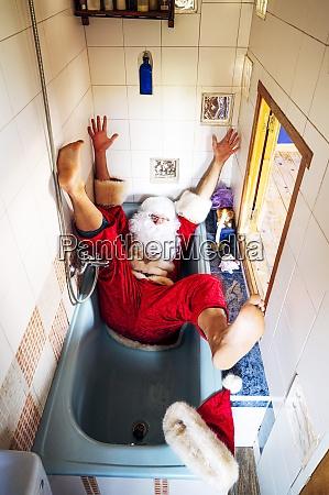 man wearing santa claus costume falling