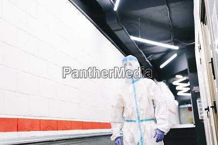 healthcare man standing in hospital corridor