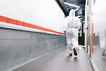 healthcare man walking while wearing protective