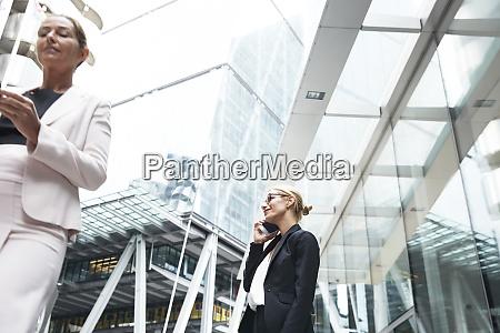 mature female entrepreneur talking on mobile