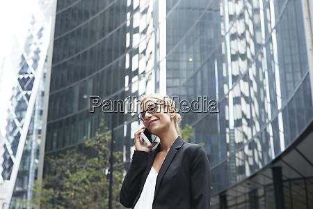 smiling beautiful businesswoman talking on mobile