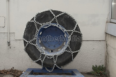 snow chains on a vehicle tire