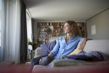 smiling woman looking away while sitting