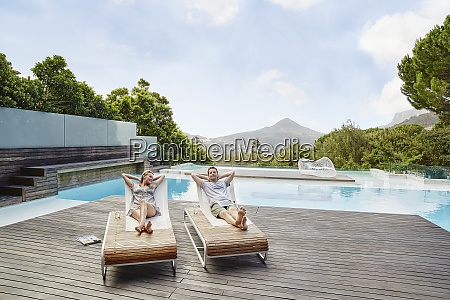 couple resting on deck chair with