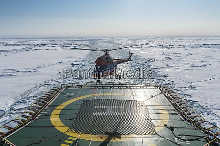 helicopter landing on helipad of ice
