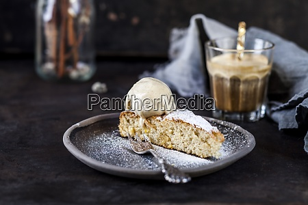 slice of spanishgatodealmendrascake and glass of