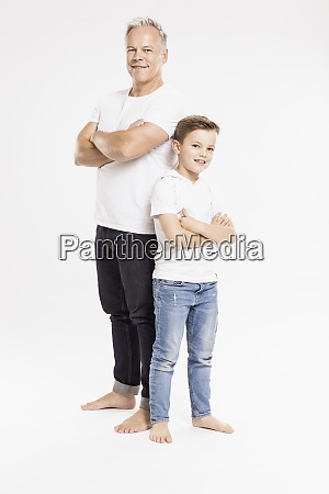 father and son with arms crossed