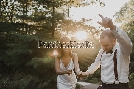 couple enjoying while dancing in forest
