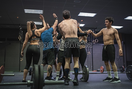 group of athletes giving high five