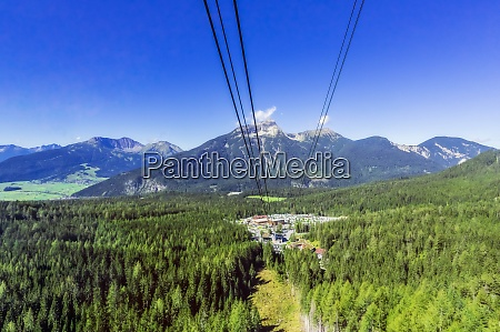 austria tyrol ski lift and tourist