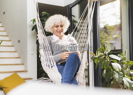 mature woman text messaging on smart