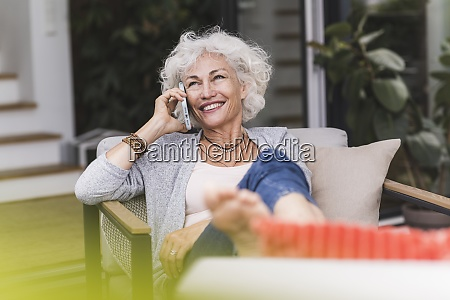 smiling mature woman talking on mobile