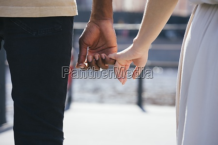 couple holding finger while standing on