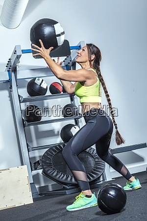 female athlete exercising with medicine ball