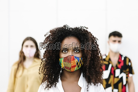 young woman wearing face mask with