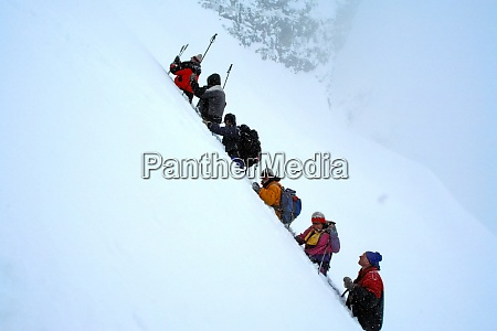 company of skiers in the mountains