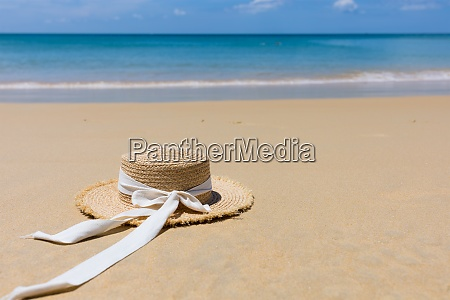 straw hat on the beach