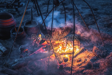 boiling cauldron with mysterious decoction at