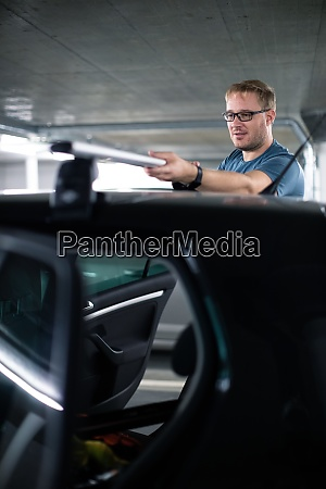 handsome young driver getting ready to
