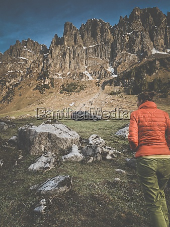 young woman in a scenic alpine