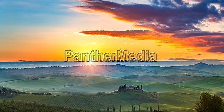 tuscany landscape at spring foggy sunrise