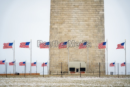 flagpole near washington monument at winter