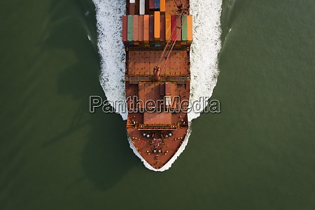 a large container ship sails to