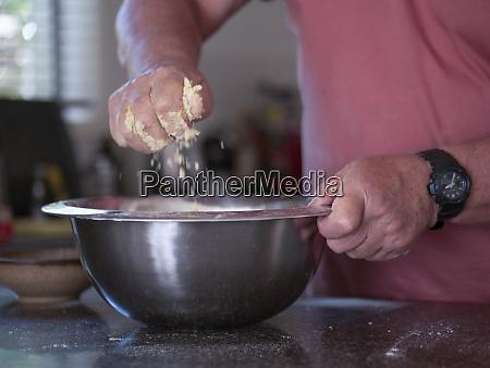 man mixing ingredients for cake